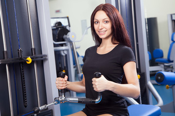 Beautiful slim woman training in a gym