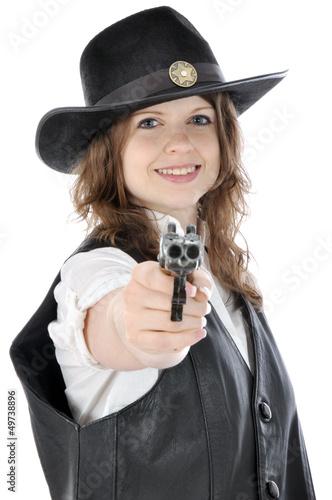 junge frau im cowboy kost m zielt mit pistole stockfotos und lizenzfreie bilder auf fotolia. Black Bedroom Furniture Sets. Home Design Ideas