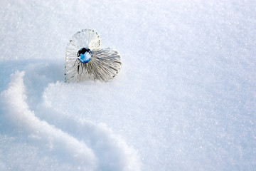 beautiful crysta heart in the snow in a winter day