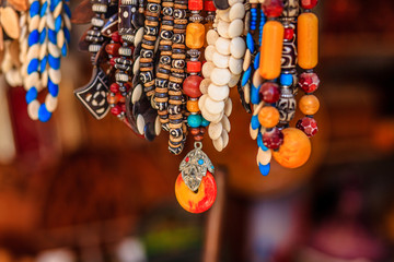 Row of handmade stylish colorful necklaces