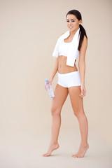 Full body shot of smiling sporty girl