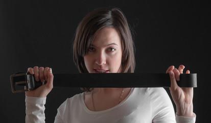girl holds a belt