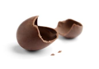 Cracked chocolate egg, isolated on white