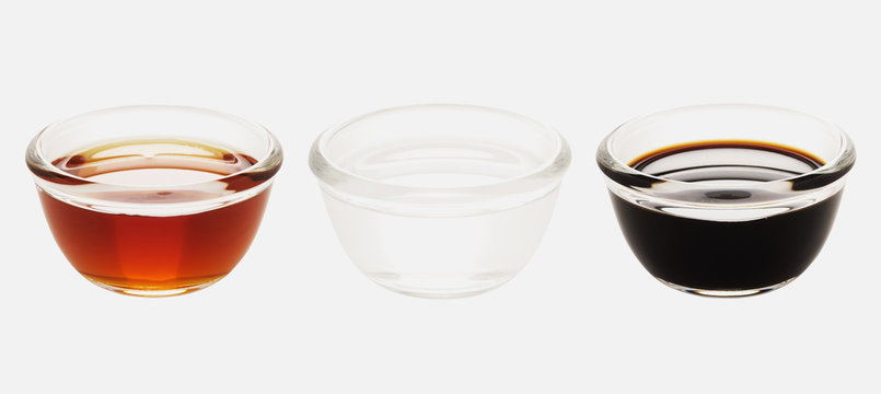 close up of bowls of red white and black vinegar