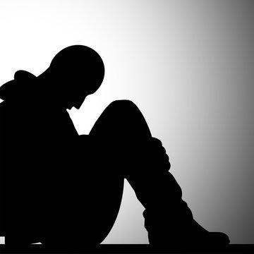 A solidão e a depressão - ilustração a preto e branco - silhueta de um homem deprimido