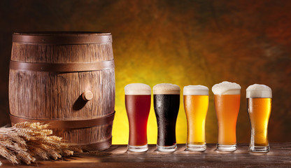 Wall Mural - Beer glasses with a wooden barrel.