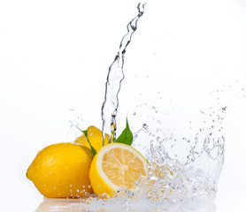 Fresh lemons with water splash, isolated on white background