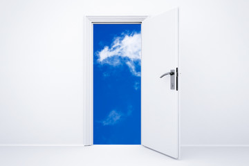 Opened white door with cloudy sky