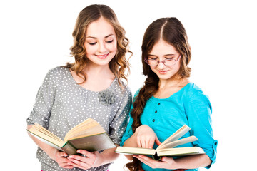 Two little beautiful girl reading a book