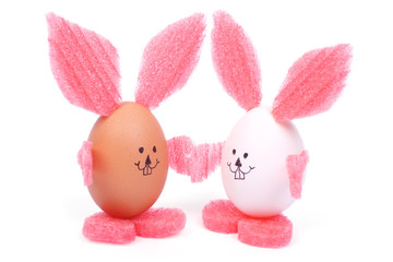 two Easter bunny holding hands made eggs isolated