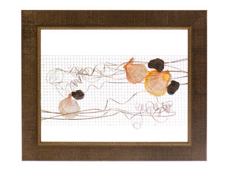 Decorative photo frame with abstract composition of shells, ston