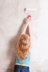 girl painting the wall