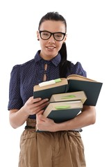 Pretty student with books smiling