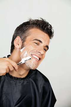 Happy Man Shaving His Face