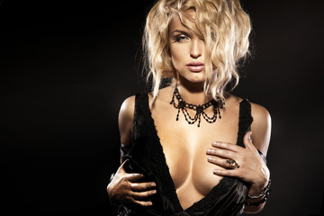 Portrait of wonderful blonde lady wearing black necklace.