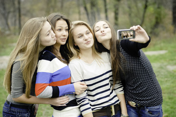 Four teen girls taking picture of themselves