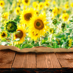 Empty table for Your photo montage with sunflowers in background