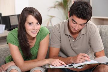 Teenage couple studying