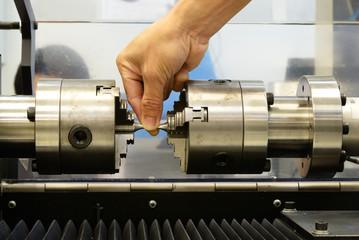 Check the torsion specimen before test on torsion testing machin