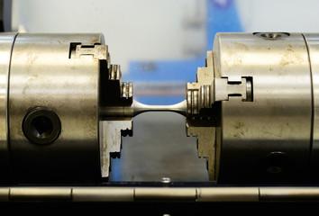 Complete setting the torsion specimen to test on torsion machine