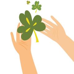 Hands holding clover leaf