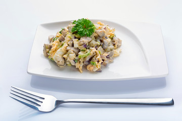 Eggs and mushrooms salad with leek and red onion on the plate