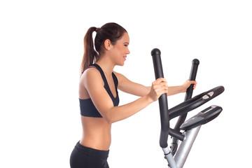Sporty brunette woman on  exerciser