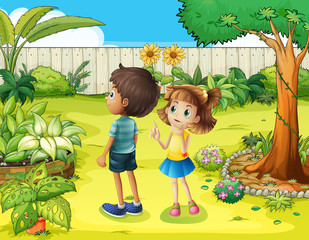A boy and a girl discussing in the garden