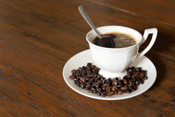 Wall Murals Coffee beans Coffee cup with Coffee Beans on grunge wood