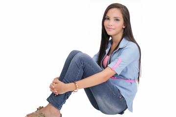 Happy college girl sitting on floor