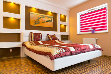 Master bedroom interior with picture of shipwreck on the wall