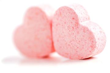 Sweet hearts shaped pink Sugar Pills. Soft Focus.