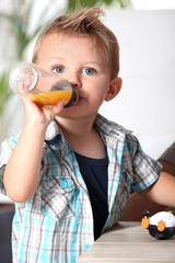 boy with baby bottle