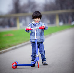 boy with scooter