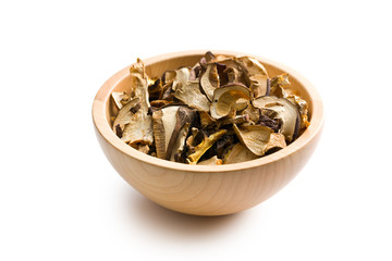 dried mushrooms in wooden bowl