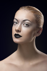 blonde girl with dark lipstick turned of three quarters