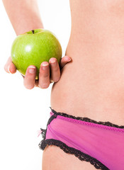 young girl with perfect body and apple in hand