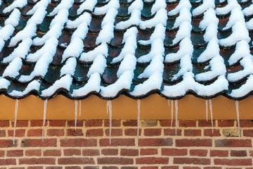 Icicles on the roof of an old Dutch farm