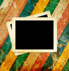 Blank photo frames on the wood background