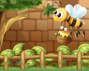 A bee holding a honey inside the fence