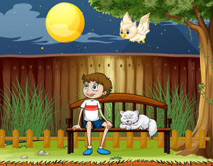 Deurstickers Katten A boy sitting with his cat inside the fence