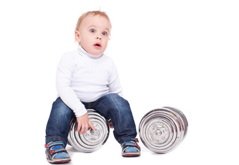 The little boy with dumbbells. On a white background.