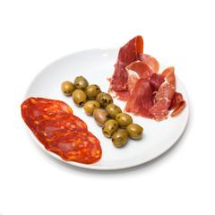Spanish tapas platter isolated on a white studio background.