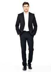 Portrait of smiling businessman in black suit