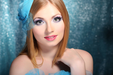 Portrait of beautiful young woman with glamour make up,