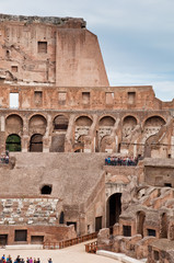 Fototapete - Walls and arcs inside Colosseum at Rome