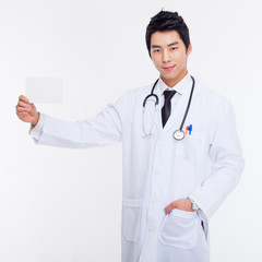 Young Asian doctor showing card