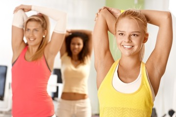 Pretty girl exercising in group