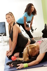 Pretty girls exercising in health club