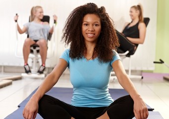 Ethnic girl relaxing at the gym